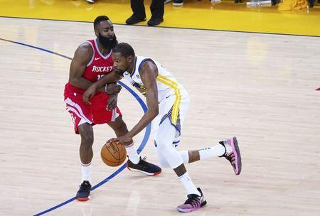May 20, 2018; Oakland, CA, USA; Golden State Warriors forward Kevin Durant (35) drives in against Houston Rockets guard James Harden (13) during the third quarter of game three of the Western conference finals of the 2018 NBA Playoffs at Oracle Arena. Mandatory Credit: Kelley L Cox-USA TODAY Sports