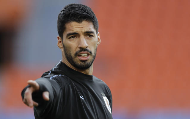 Uruguay's Luis Suarez gestures during Uruguay's official training on the eve of the group A match between Egypt and Uruguay at the 2018 soccer World Cup in the Yekaterinburg Arena in Yekaterinburg, Russia, Thursday, June 14, 2018. (AP Photo/Natacha Pisarenko)