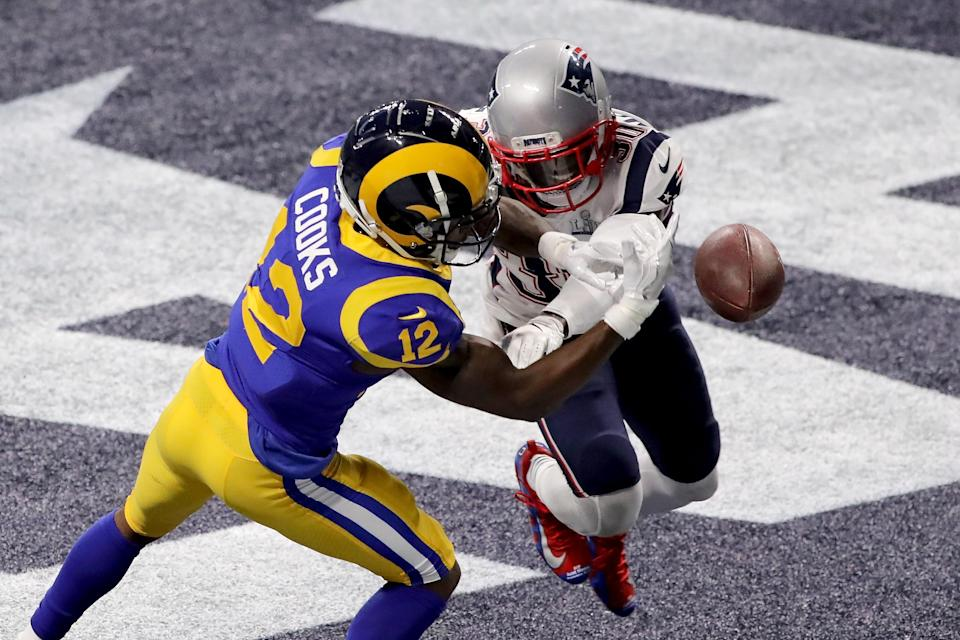Brandin Cooks, 12, of the Los Angeles Rams drops a pass in the end zone as he is defended by Jason McCourty of the New England Patriots. (Getty Images)