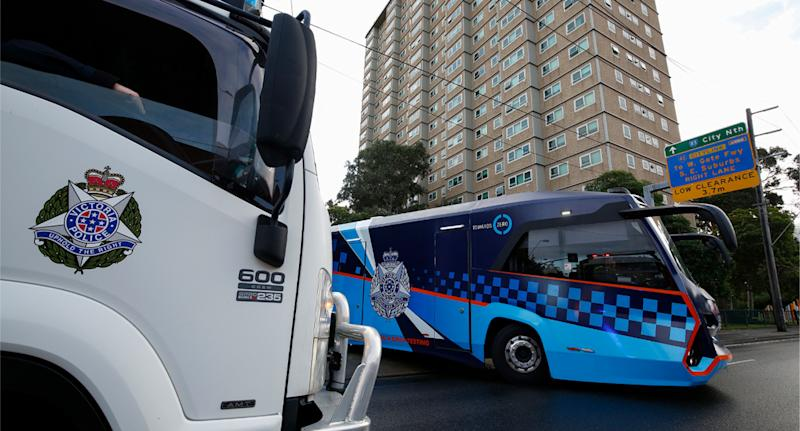Police patrols outside one of the public housing towers on Racecourse Road in Flemington on Sunday. Source: AAP