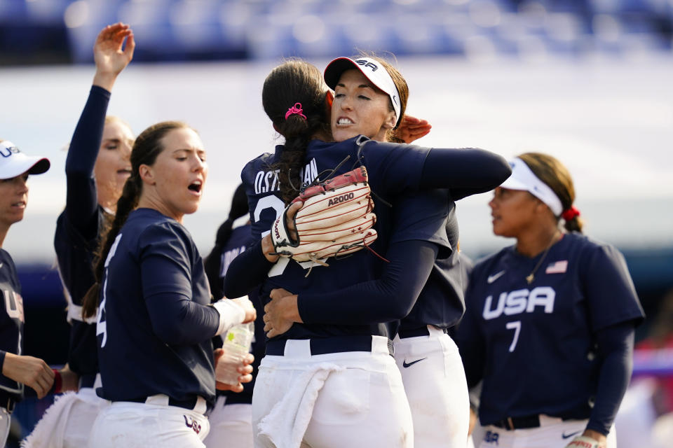 United States' Monica Abbott, center right, and Cat Osterman, center left, embrace defeating Mexico during a softball game at the 2020 Summer Olympics, Saturday, July 24, 2021, in Yokohama, Japan. (AP Photo/Matt Slocum)