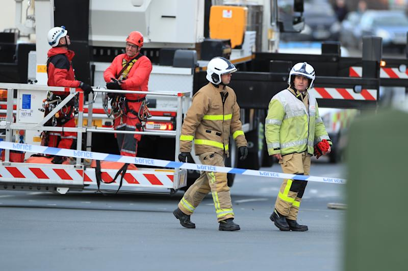 Urban Search and Rescue team members from Lancashire Fire and Rescue Service, prepare to use a hydraulic platform at Dixon's Chimney in Carlisle, Cumbria, where a man, whose condition is currently unknown, continues to hang upside down from the top of the chimney 270ft up. PA Photo. Picture date: Monday October 28, 2019. Local reports said shouts and wailing could be heard coming from the chimney in the early hours of this morning before police arrived on the scene. See PA story POLICE Chimney. Photo credit should read: Danny Lawson/PA Wire