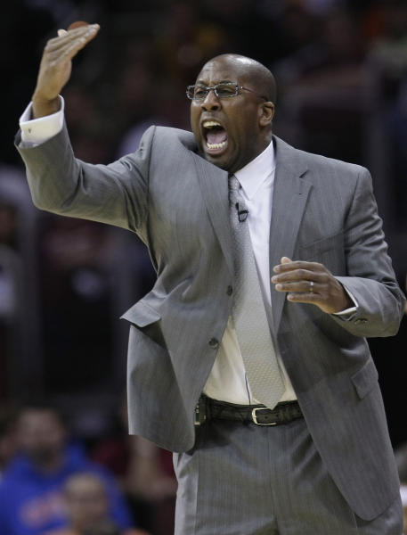 FILE - In this April 17, 2010 file photo, Cleveland Cavaliers coach Mike Brown yells at his team in the third quarter of Game 1 against the Chicago Bulls in the first round of the NBA basketball playoffs in Cleveland. Cleveland officially re-hired Mike Brown on Wednesday, April 24, 2013, bringing back a coach who guided them to five straight playoff appearances and their only trip to the NBA Finals before he was fired following the 2010 season. (AP Photo/Tony Dejak, File)