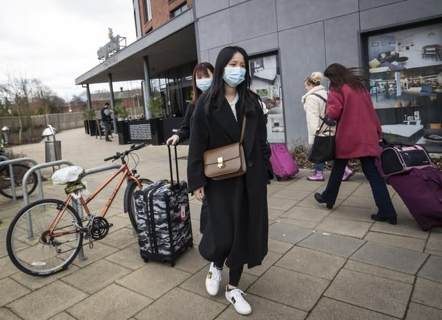 Two women wearing face masks leave the Staycity Hotel in York