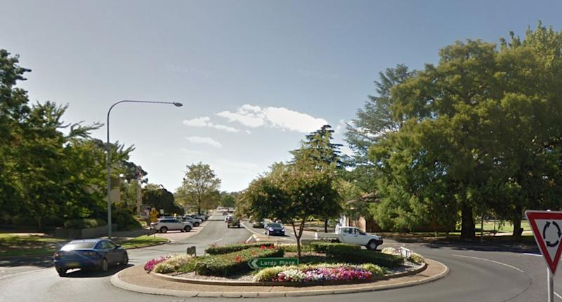 Cars using roundabout in Orange, NSW, as road rules for each state is explained.