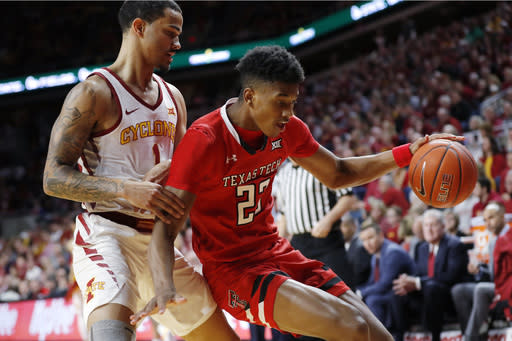 Texas Tech guard Jarrett Culver drives past Iowa State guard Nick Weiler-Babb, left, during the first half of an NCAA college basketball game, Saturday, March 9, 2019, in Ames, Iowa. (AP Photo/Charlie Neibergall)