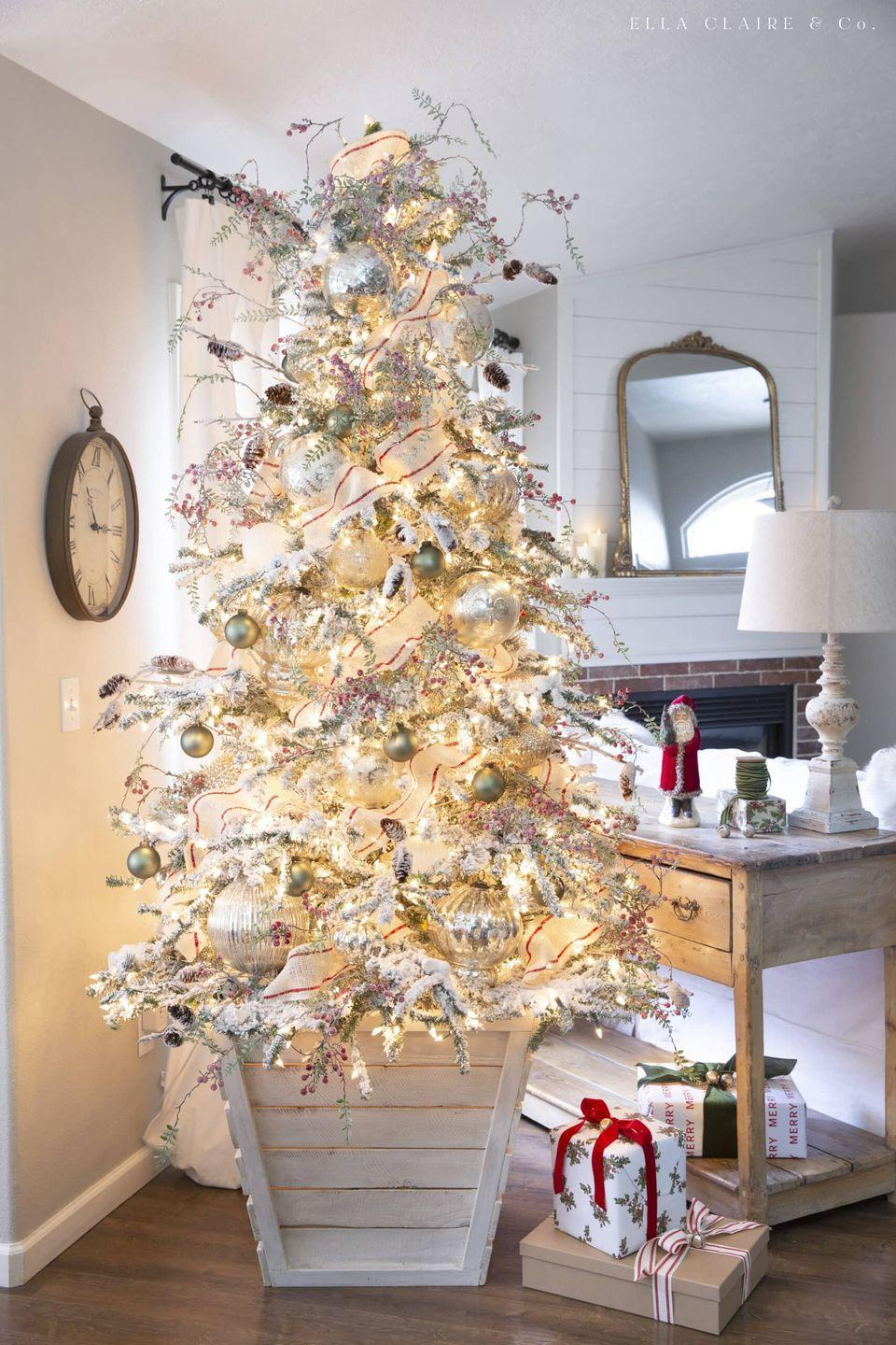 """<p>Vintage accents, mercury glass, and frosted berries and pinecones make up the bulk of this beautiful Christmas tree. </p><p><strong><em>Get the tutorial at <a href=""""https://www.ellaclaireinspired.com/vintage-red-and-green-christmas-tree/"""" rel=""""nofollow noopener"""" target=""""_blank"""" data-ylk=""""slk:Ella Claire & Co"""" class=""""link rapid-noclick-resp"""">Ella Claire & Co</a>.</em></strong></p><p><a class=""""link rapid-noclick-resp"""" href=""""https://www.amazon.com/Creative-Co-op-Embossed-Ornaments-OrnamentOrnament/dp/B07NW5462B?tag=syn-yahoo-20&ascsubtag=%5Bartid%7C10070.g.2025%5Bsrc%7Cyahoo-us"""" rel=""""nofollow noopener"""" target=""""_blank"""" data-ylk=""""slk:BUY MERCURY GLASS ORNAMENTS"""">BUY MERCURY GLASS ORNAMENTS</a></p>"""