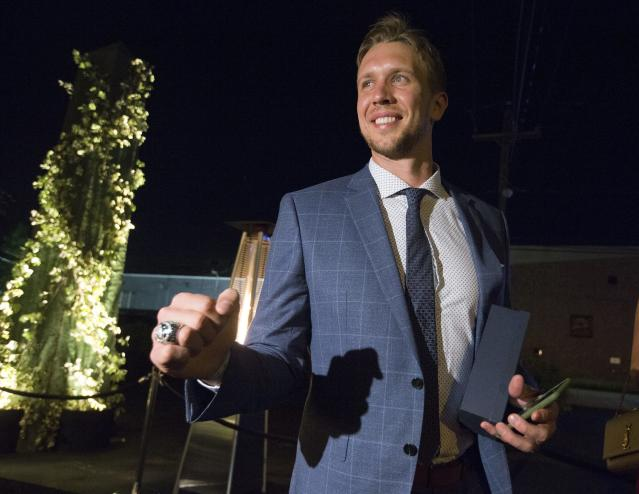 In this Thursday night, June 14, 2018 photo, Philadelphia Eagles quarterback Nick Foles shows off his Super Bowl ring as the Eagles were presented them at a private party in Philadelphia. (Charles Fox/The Philadelphia Inquirer via AP)