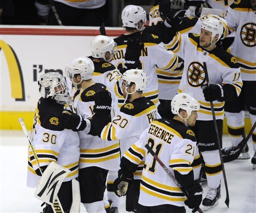 Chara lifts Bruins past Caps 4-3 for series lead