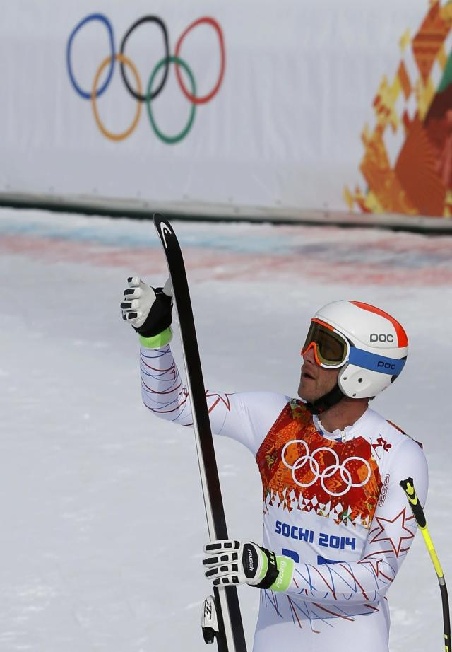 REFILE - CORRECTING BYLINE Bode Miller of the U.S. reacts in the finish area after competing in the men's alpine skiing downhill race during the 2014 Sochi Winter Olympics at the Rosa Khutor Alpine Center February 9, 2014. REUTERS/Leonhard Foeger (RUSSIA - Tags: SPORT OLYMPICS SPORT SKIING)