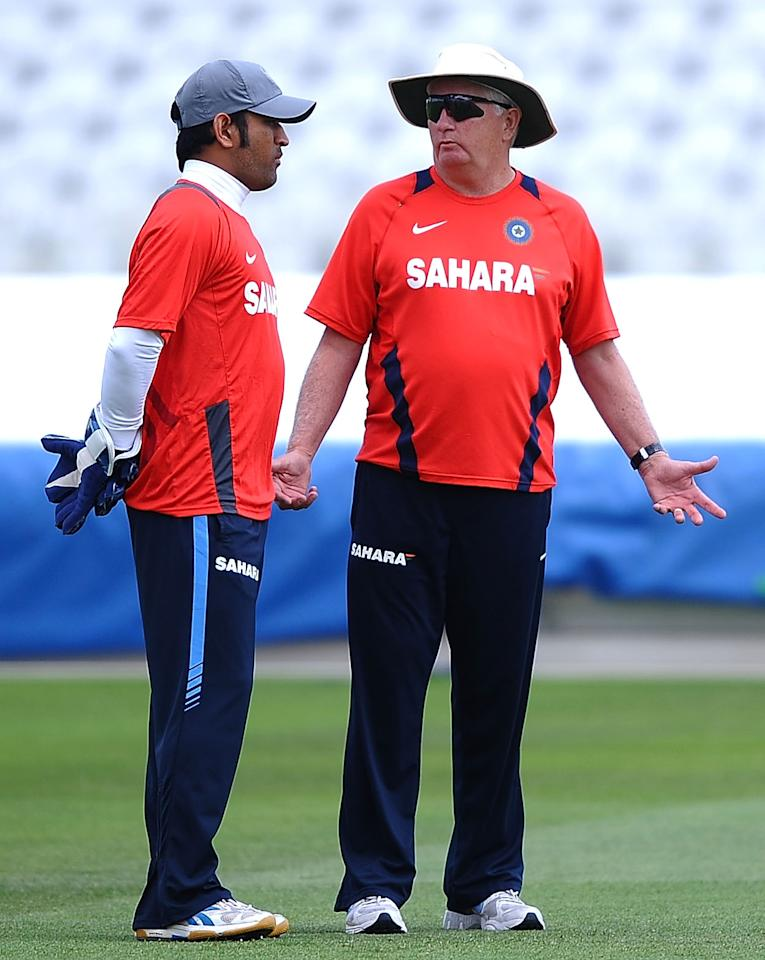 NOTTINGHAM, ENGLAND - JULY 28:  Mahendra Singh Dhoni of India talks with Duncan Fletcher during Net Practice ahead of the second Test match at Trent Bridge on July 28, 2011 in Nottingham, England.  (Photo by Laurence Griffiths/Getty Images)