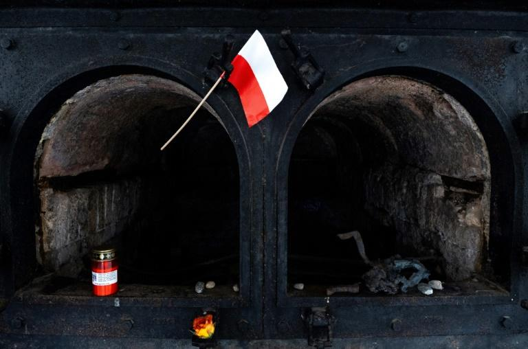 A Polish flag waves in front of a crematorium oven at the former site of the Gusen death camp in Austria, which Warsaw is pushing to be memorialised (AFP Photo/JOE KLAMAR)