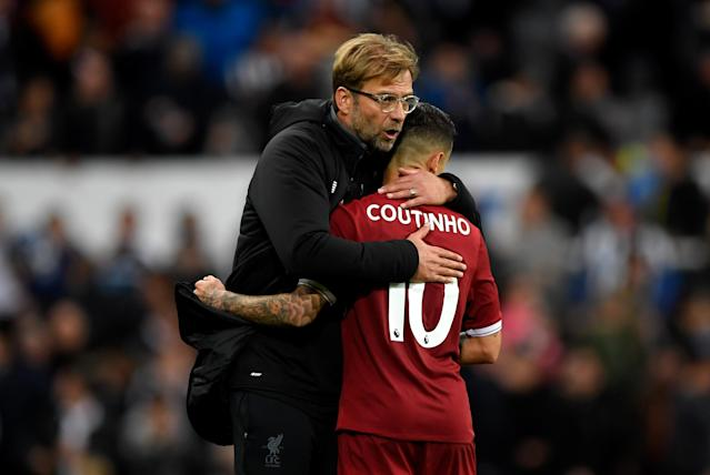 "<a class=""link rapid-noclick-resp"" href=""/soccer/teams/liverpool/"" data-ylk=""slk:Liverpool"">Liverpool</a> manager Jurgen Klopp hugs <a class=""link rapid-noclick-resp"" href=""/soccer/players/philippe-coutinho/"" data-ylk=""slk:Philippe Coutinho"">Philippe Coutinho</a>. Could the player's transfer to <a class=""link rapid-noclick-resp"" href=""/soccer/teams/barcelona/"" data-ylk=""slk:Barcelona"">Barcelona</a> have waited six more months?"