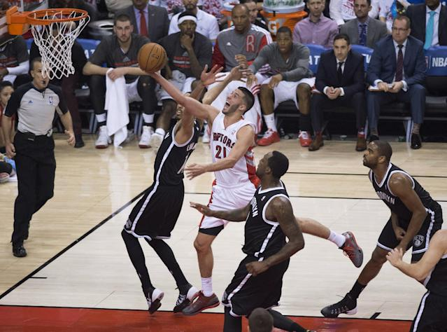 Toronto Raptors' Greivis Vasquez drives through the Brooklyn Nets defense during the first half of Game 1 of an opening-round NBA basketball playoff series, in Toronto on Saturday, April 19, 2014. (AP Photo/The Canadian Press, Darren Calabrese)