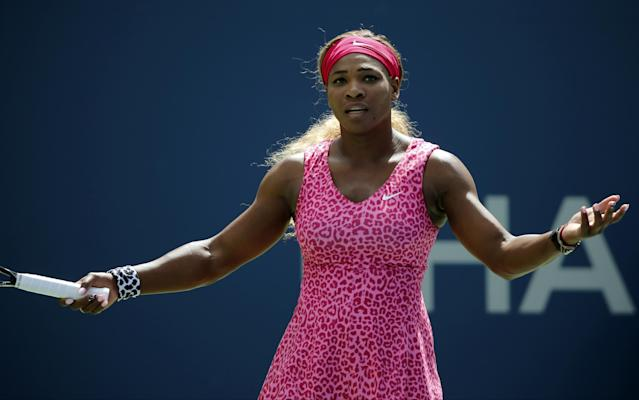 Serena Williams, of the United States, motions to her box between points against Vania King, of the United States, during the second round of the 2014 U.S. Open tennis tournament, Thursday, Aug. 28, 2014, in New York. (AP Photo/Elise Amendola)