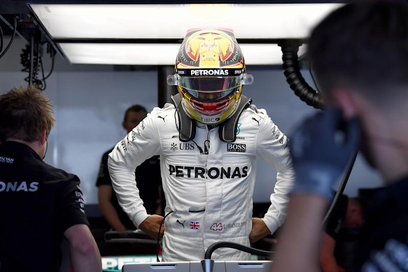 Battle | Lewis Hamilton trails Sebastian Vettel by seven points after three races: AFP/Getty Images