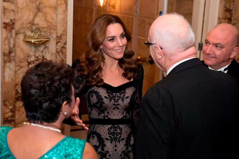 The Duchess of Cambridge speaks to guests as she arrives to attend the Royal Variety Performance (POOL/AFP via Getty Images)