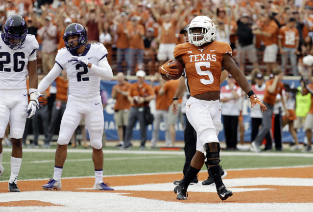 Texas running back Tre Watson (5) struts through the end zone after scoring a touchdown against TCU during the first half of an NCAA college football game, Saturday, Sept. 22, 2018, in Austin, Texas. (AP Photo/Eric Gay)