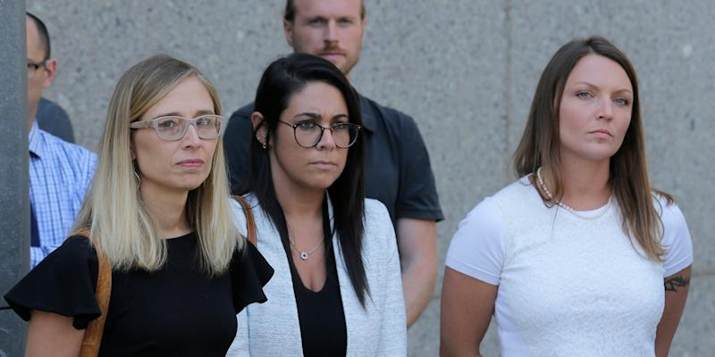 Annie Farmer, left, and Courtney Wild, right, accusers of Jeffery Epstein, stand outside the courthouse in New York, Monday, July 15, 2019.