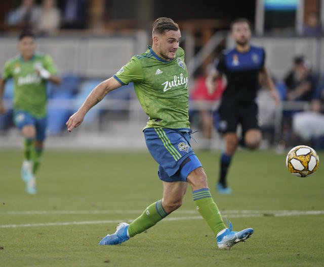 Seattle Sounders forward Jordan Morris (13) scores a goal against the San Jose Earthquakes during the second half of an MLS soccer match Sunday, Sept. 29, 2019, in San Jose, Calif. The Seattle Sounders won 1-0. (AP Photo/Tony Avelar)