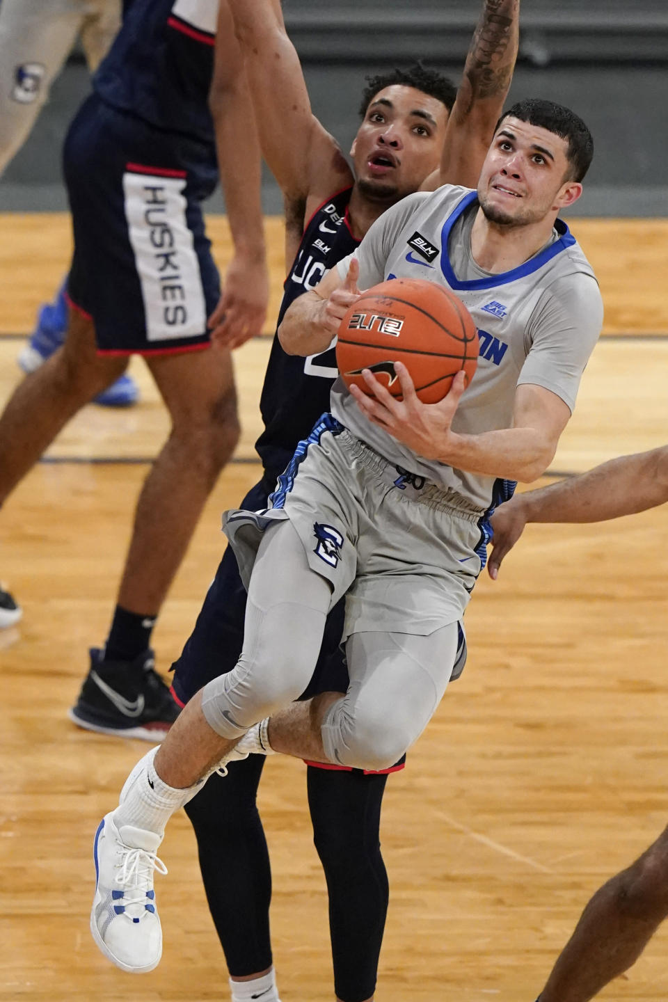 Creighton's Marcus Zegarowski drives past Connecticut's James Bouknight during the second half of an NCAA college basketball game in the semifinals in the Big East men's tournament Friday, March 12, 2021, in New York. (AP Photo/Frank Franklin II)