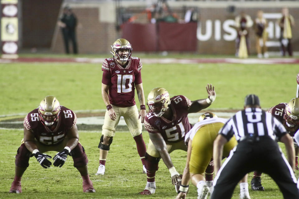 Florida State quarterback McKenzie Milton (10) waits for the snap in overtime of an NCAA college football game against Notre Dame Sunday, Sept. 5, 2021, in Tallahassee, Fla. Notre Dame won 41-38. (AP Photo/Phil Sears)
