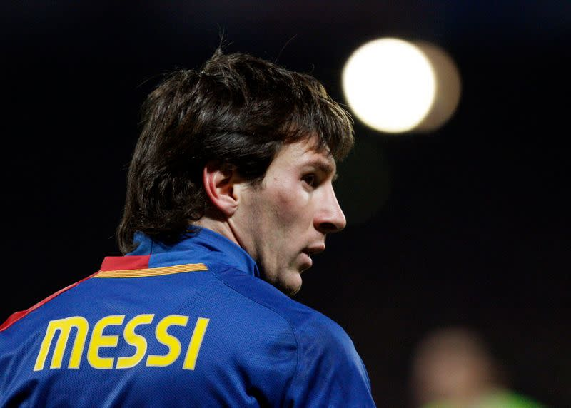Barcelona's Messi looks on after missing a scoring opportunity against Olympique Lyon during their Champion's League soccer match at the Gerland stadium in Lyon
