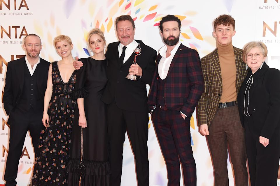 """LONDON, ENGLAND - JANUARY 28: (L to R) Anthony Byrne, Kate Philips, Sophie Rundle, Steven Knight, Emmett J. Scanlan, Harry Kirton and guest, accepting the Best Drama award for """"Peaky Blinders"""", pose in the winners room at the National Television Awards 2020 at The O2 Arena on January 28, 2020 in London, England. (Photo by David M. Benett/Dave Benett/Getty Images)"""