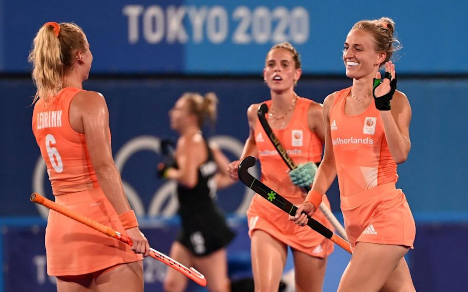 Netherlands' Lauren Lara Jeanette Stam (R) celebrates with teammate Laurien Leurink after scoring against New Zealand in the impressive quarter-final win - GETTY IMAGES