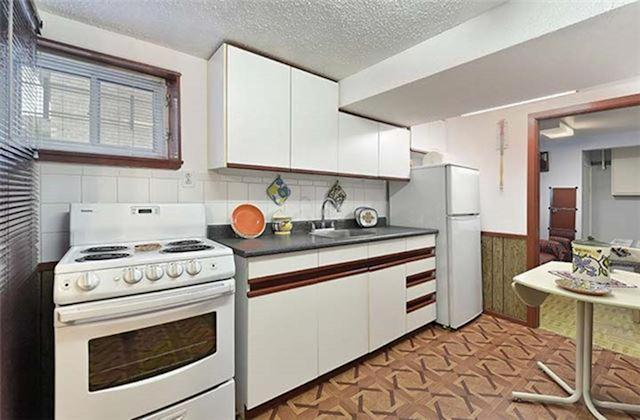 <p><span>146 Pitt Ave., Toronto, Ont.</span><br> There is also a dedicated kitchen in the basement, which also comes with the fridge and stove.<br> (Photo: Zoocasa) </p>