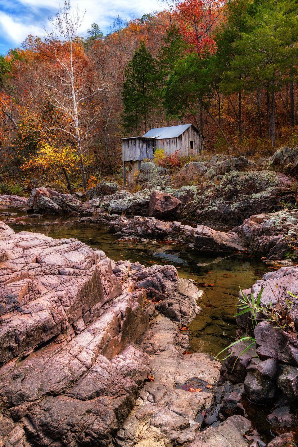 """<p><strong>Where to go:</strong> The Ozark National Scenic Riverways features brilliant fall colors along its creeks, falls, and springs. Check out Klepzing Mill — a 1928 sawmill house — and other local treasures. </p><p><strong>When to go: </strong>Mid-October</p><p><a class=""""link rapid-noclick-resp"""" href=""""https://go.redirectingat.com?id=74968X1596630&url=https%3A%2F%2Fwww.tripadvisor.com%2FHotels-g44758-Ozark_Missouri-Hotels.html&sref=https%3A%2F%2Fwww.redbookmag.com%2Flife%2Fg34045856%2Ffall-colors%2F"""" rel=""""nofollow noopener"""" target=""""_blank"""" data-ylk=""""slk:FIND A HOTEL"""">FIND A HOTEL</a></p>"""