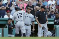 New York Yankees' Rougned Odor (12) celebrates after scoring on an RBI-single by Gleyber Torres during the eighth inning of a baseball game against the Boston Red Sox, Saturday, July 24, 2021, in Boston. (AP Photo/Michael Dwyer)