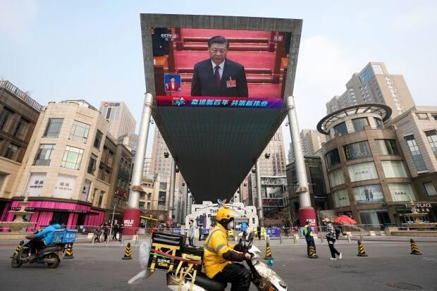 Chinese President Xi Jinping is seen on a big screen during a live broadcast of the closing session of the National People's Congress in Beijing on Thursday, March 11, 2021. (Ng Han Guan/Associated Press - image credit)