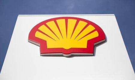 A logo for Shell is seen on a garage forecourt in central London