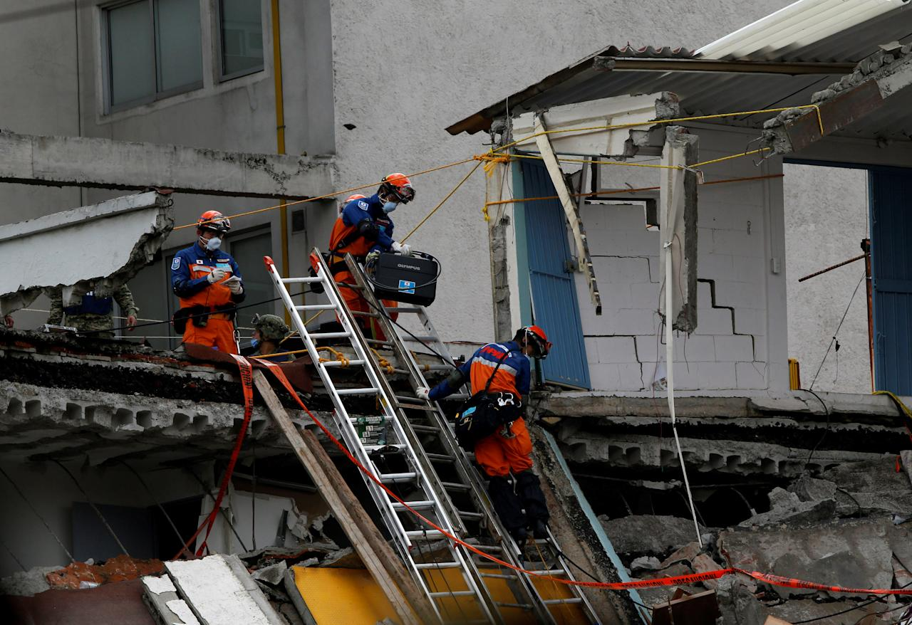 Members from Japan rescue team searches for survivors in the rubble of a collapsed building after an earthquake in Mexico City, Mexico September 22, 2017. REUTERS/Henry Romero