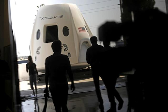 HAWTHORNE, CA - AUGUST 13, 2018 - A prototype of the Crew Dragon space craft was on display for members of the media at SpaceX in Hawthorne on August 13, 2018. This image was a reflection made in a nearby window. (Genaro Molina/Los Angeles Times)