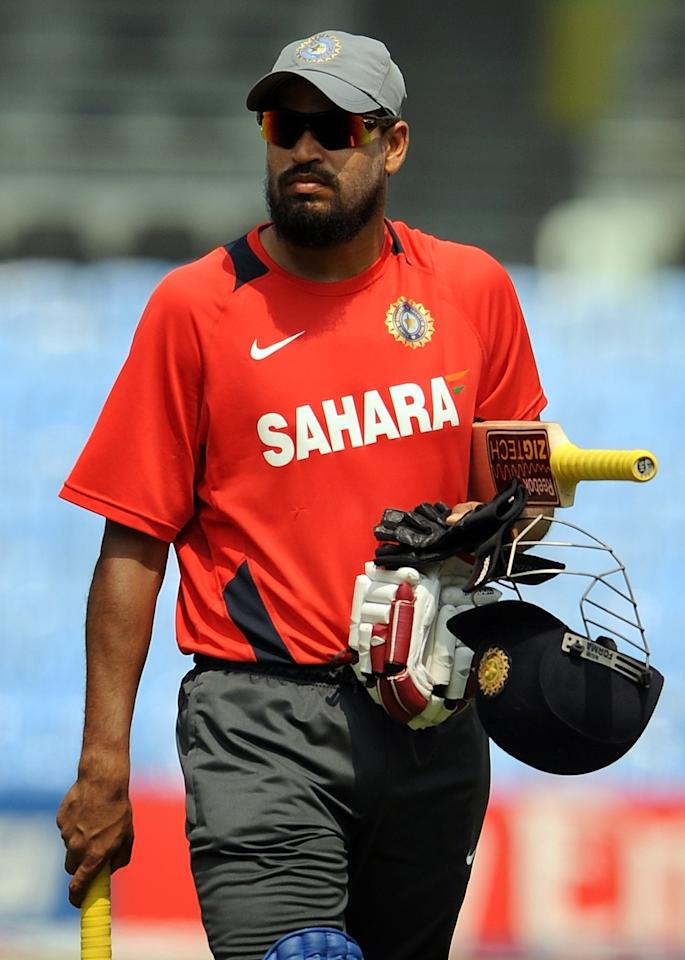 India's Yusuf Pathan walks back towards the pavilion after batting at the nets during a cricket training session at the M.A. Chidambaram Stadium in Chennai on February 15, 2011. India will play their warm-up match against New Zealand on February 16. The 2011 Cricket World Cup takes place in India, Sri Lanka and Bangladesh from February 19-April 2 with 14 nations taking part in the marathon six-week tournament. AFP PHOTO/ Punit PARANJPE (Photo credit should read PUNIT PARANJPE/AFP/Getty Images)