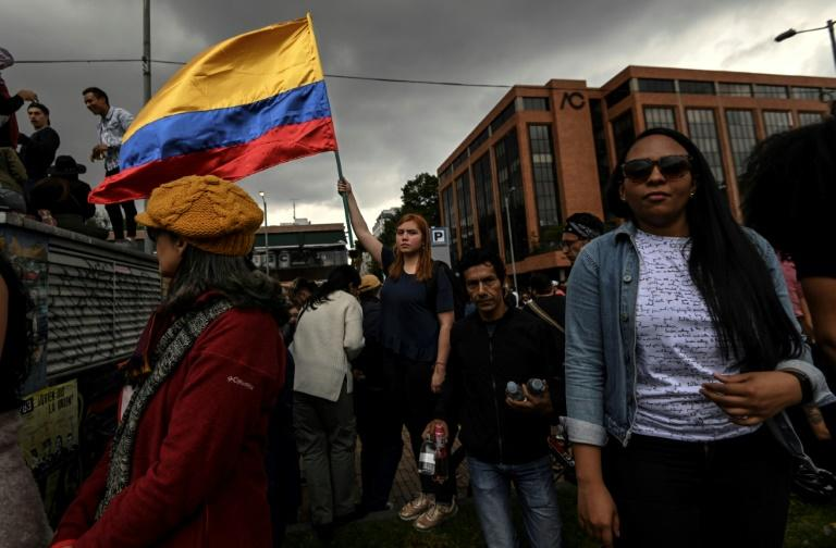 A woman waves a Colombian national flag during a concert organized by Colombian musicians and artists to support protests against the government of President Ivan Duque in Bogota