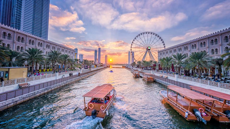 Eye of the Emirates - ferris wheel in Al Qasba - Shajah at sunset - Image.