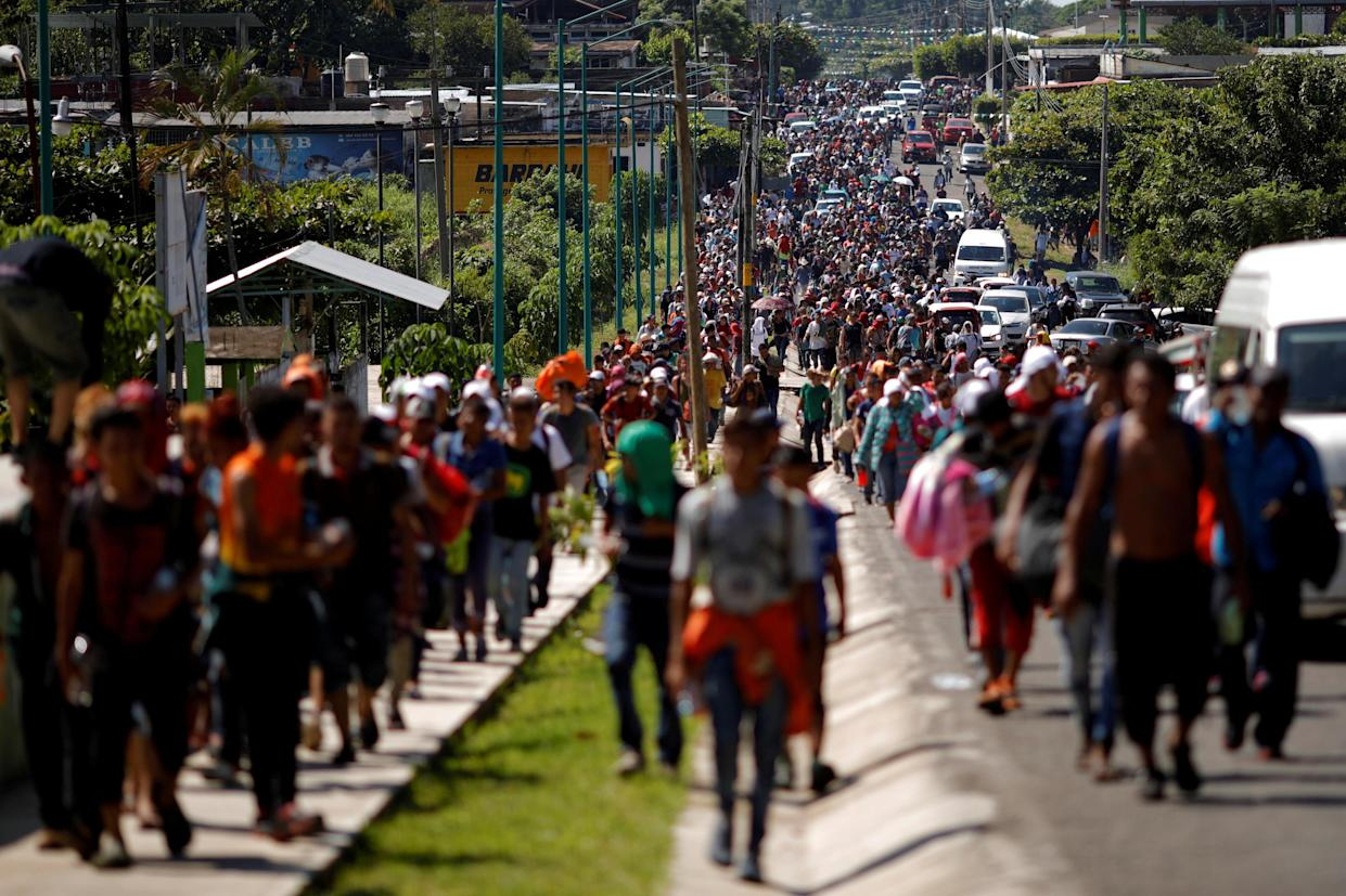 Central American migrants walk along the highway near the border with Guatemala in Tapachula, Mexico, on Sunday as they continue their attempt to reach the U.S. (Photo: Ueslei Marcelino/Reuters)