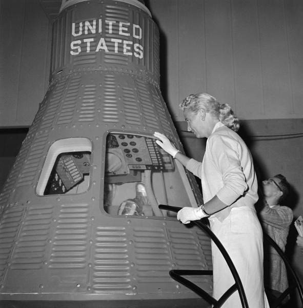 FILE - In this May 26, 1961 file photo, Jerri Cobb looks into a full-scale model of the Mercury capsule which carried Alan Shepard into space, in Tulsa, Okla. Cobb, NASA's first female astronaut candidate, died in Florida at the age of 88 on March 18, 2019. (AP Photo/William P. Straeter)