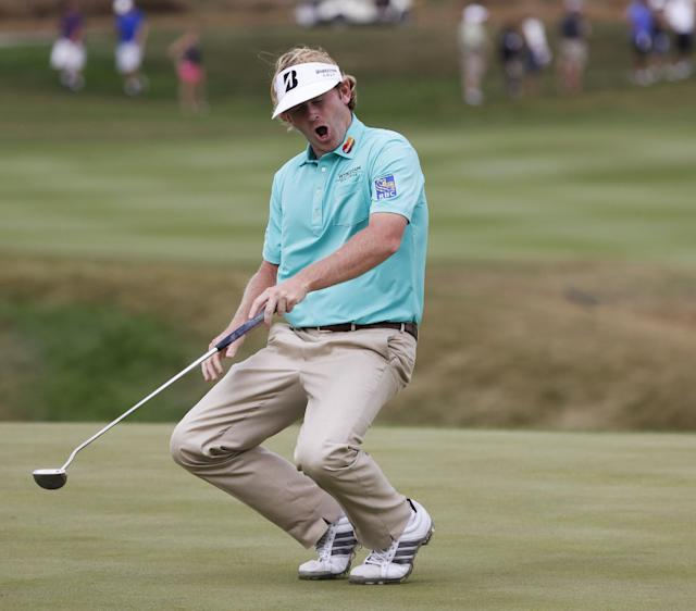 Brandt Snedeker reacts after missing a birdie attempt on the eighth green during the first round of the BMW Championship golf tournament at Conway Farms Golf Club in Lake Forest, Ill., Thursday, Sept. 12, 2013. (AP Photo/Charles Rex Arbogast)