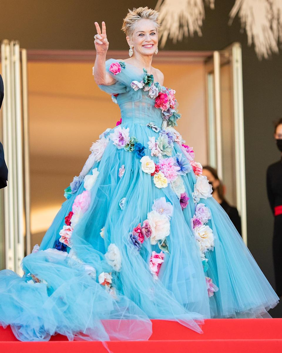 <p>Sharon Stone is stunning in a blue gown adorned with flowers at the <em>A Feleségem története</em> (<em>The Story of My Wife</em>) screening during the 74th annual Cannes Film Festival on July 14 in France.</p>