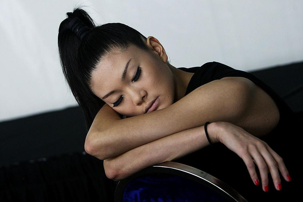 <p>A model sleeps while keeping her hair and makeup intact ahead of an Emanuel Ungaro show. (Photo: Getty Images) </p>