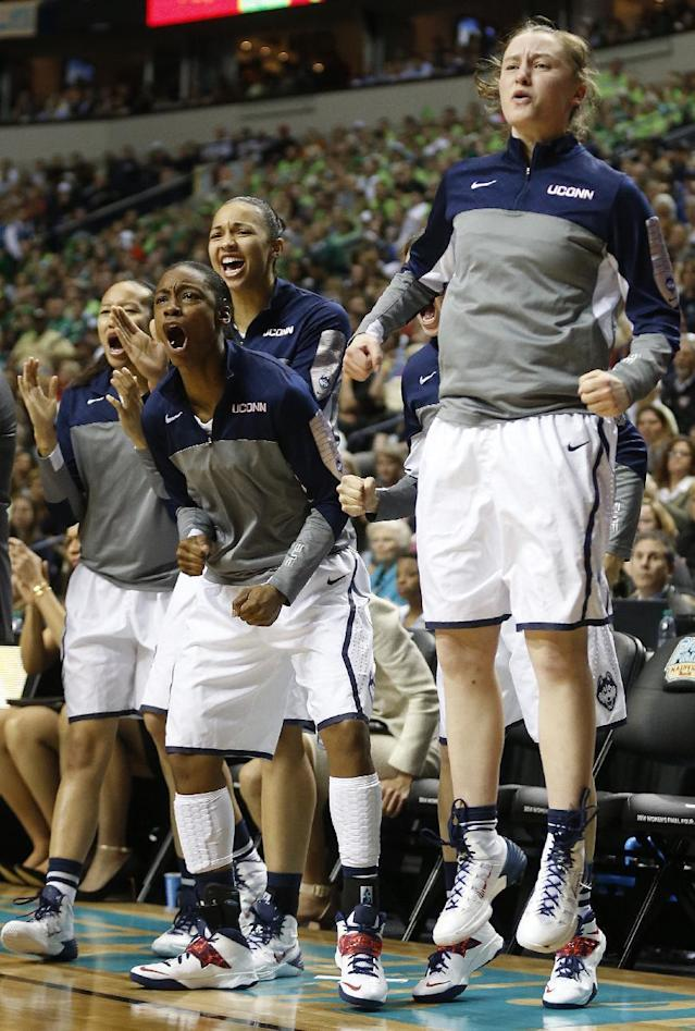 The Connecticut bench cheers against Notre Dame during the first half of the championship game in the Final Four of the NCAA women's college basketball tournament, Tuesday, April 8, 2014, in Nashville, Tenn. (AP Photo/John Bazemore)