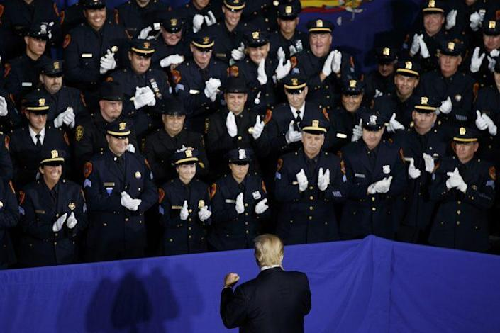 Law enforcement officers with President Donald Trump