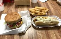 """<p>It's easy to get a vintage feel at a drive-in, but it's much harder to actually <a href=""""https://www.thedailymeal.com/eat/what-dollar-bought-year-you-were-born-gallery?referrer=yahoo&category=beauty_food&include_utm=1&utm_medium=referral&utm_source=yahoo&utm_campaign=feed"""" rel=""""nofollow noopener"""" target=""""_blank"""" data-ylk=""""slk:get a vintage price"""" class=""""link rapid-noclick-resp"""">get a vintage price</a>. At Ammons Drive Inn & Dairy Bar in Waynesville, North Carolina, you can still get a cheeseburger for just $2. A side of fries will cost $1.75. If you still have room after all that, you can get the cobbler, with two rotating flavors nightly.</p>"""