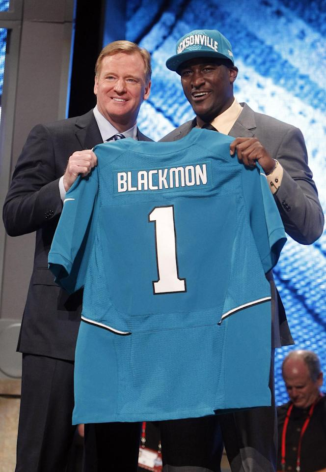 Oklahoma State wide receiver Justin Blackmon, right, poses for photographs with NFL Commissioner Roger Goodell after being selected as the fifth pick overall by the Jacksonville Jaguars in the first round of the NFL football draft at Radio City Music Hall, Thursday, April 26, 2012, in New York. (AP Photo/Jason DeCrow)