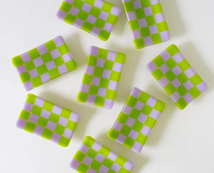 """Combining two trends we adore—joy and a checkered print—these tiny glass trays are handmade by U.K.-based artist David Perry. $25, Nata Concept Store. <a href=""""https://www.nataconceptstore.com/product-page/nata-checker-tray"""" rel=""""nofollow noopener"""" target=""""_blank"""" data-ylk=""""slk:Get it now!"""" class=""""link rapid-noclick-resp"""">Get it now!</a>"""