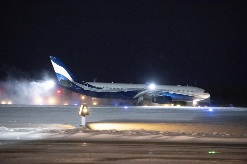A plane carrying Canadians back Wuhan, China, lands at CFB Trenton, in Trenton, Canada Friday, Feb. 7, 2020. (Justin Tang/The Canadian Press via AP)